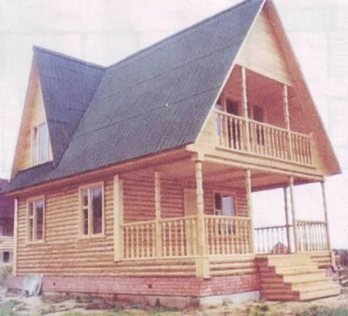 Проект компактного дома с двускатной крышей и фасадом из